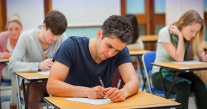 esame scritto 300x158 - Students in an exam